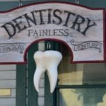 Painless dentistry street sign