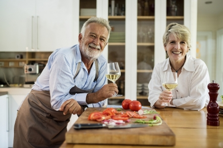 Older couple enjoying glass of wine