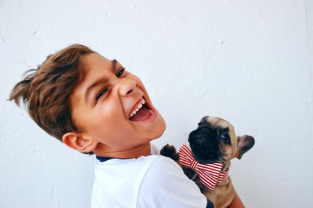 Young boy holding puppy